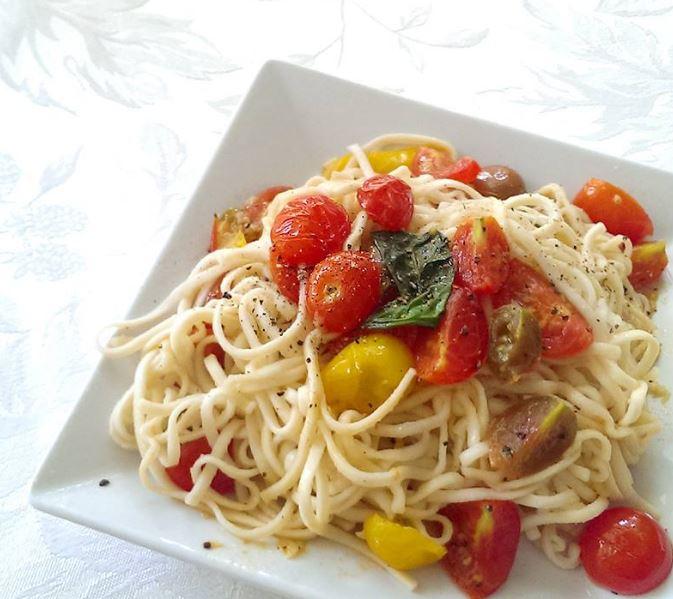 Spaghetti with cherry tomato and fresh basil pesto